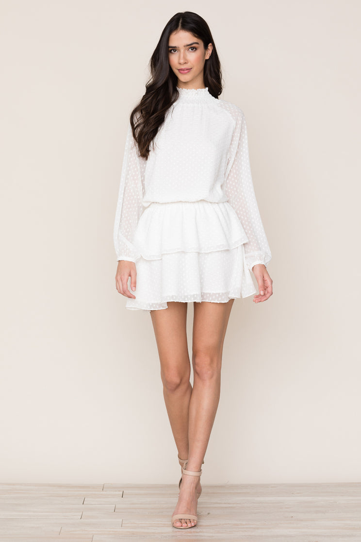 Yumi Kim's Class Act dress is a fun take on a white long sleeve mini dress that can be worn day to night.