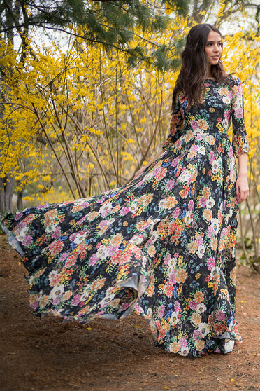 Woodstock Floral Long Dress with a flowing, full-length skirt, romantic wisteria floral print and blouson sleeves by Yumi Kim.