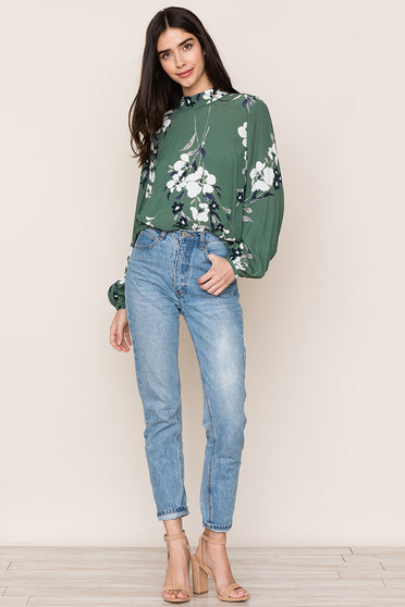 Pair Yumi Kim's Oxford Green Floral Blouse with jeans to create an effortlessly stylish look.