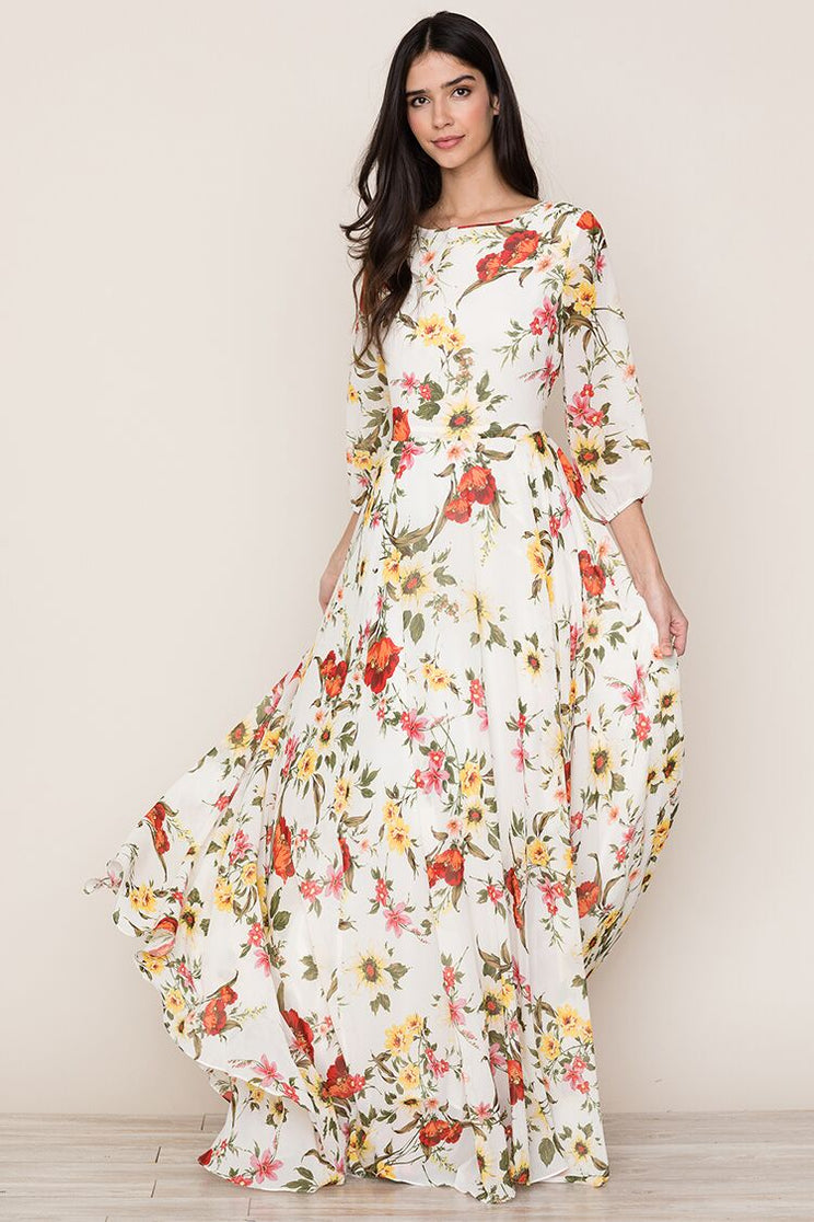 A romantic floral print complements the elegant, bohemian feel of Yumi Kim's Woodstock Floral Print Maxi Dress.