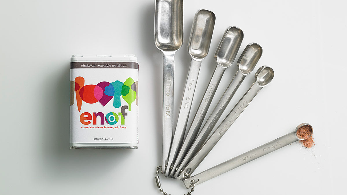 Canister of ENOF with measuring spoons showing ENOF powder