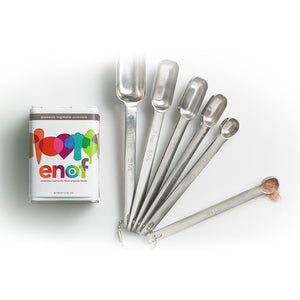 Canister of ENOF with measuring spoons and a small amount of ENOF powder