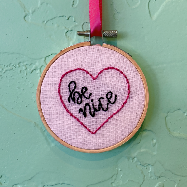 Be Nice embroidery hoop by The Offbeat Rolo