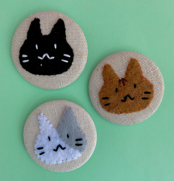 embroidered cute cat face pins by The Offbeat Rolo