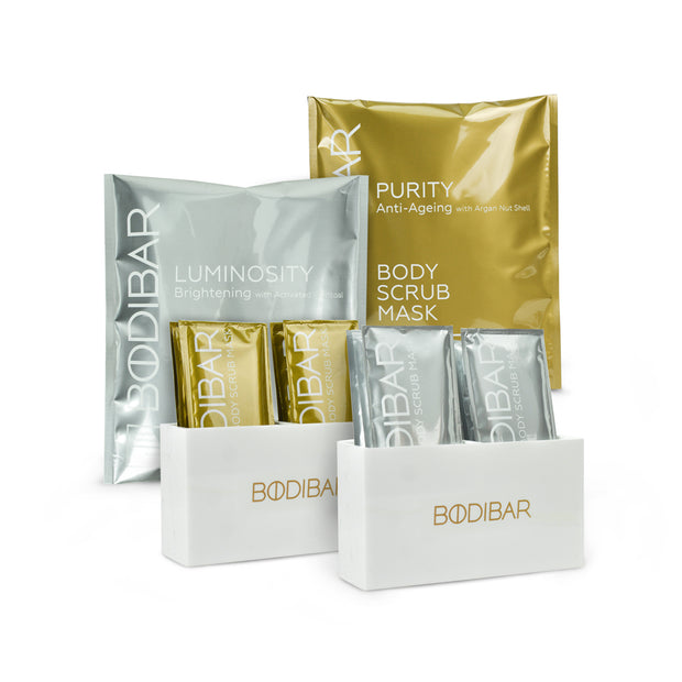 bodibar bestie kit featuring two packs of body scrub and mud mask with two shower caddy