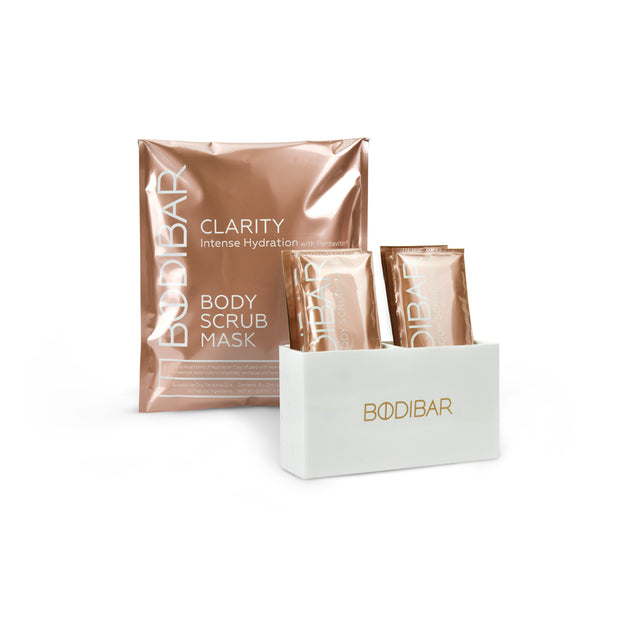 Bodibar New Naked kit featuring a retail pack of Clarity body scrub and mud mask with a custom shower caddy