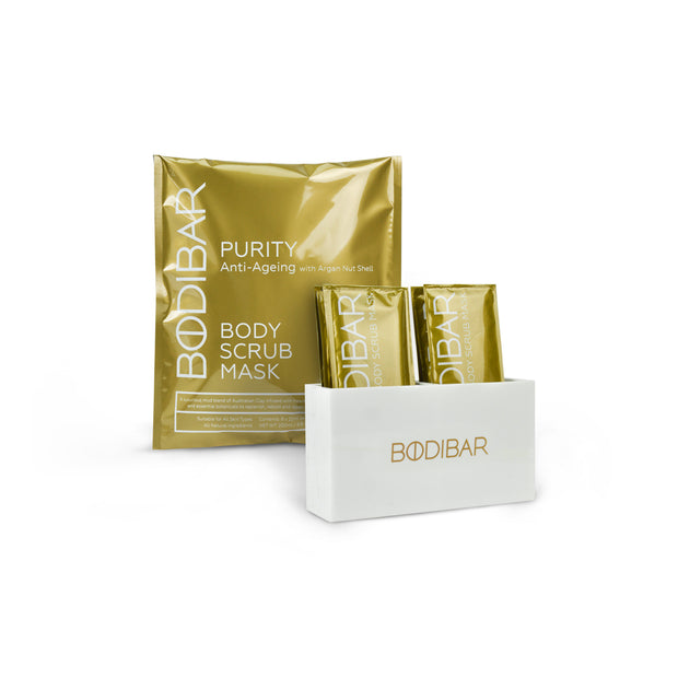 Bodibar New Naked kit featuring a retail pack of Purity body scrub and mud mask with a custom shower caddy