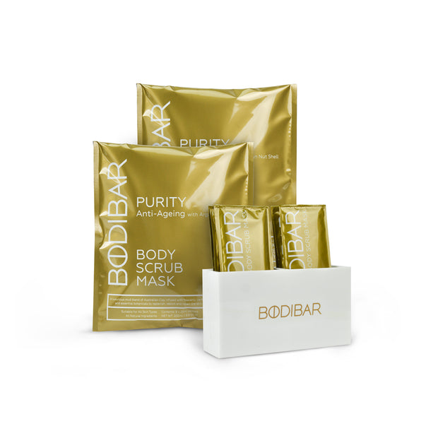 bodibar skin edit kit includes two body scrub and mud mask treatments plus a shower caddy