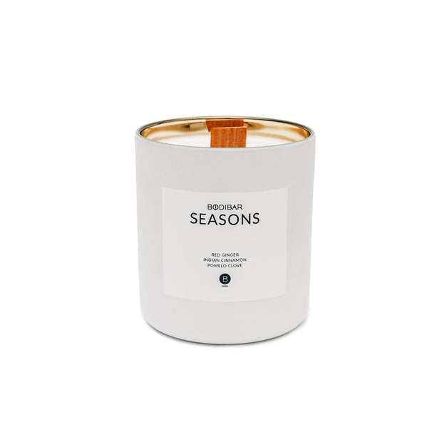 White with gold lining Seasons Christmas scented candle with natural 100% soy wax and wood wick