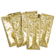 mud mask for all over body exfoliation with anti-aging ingredients packaged in gold sachets