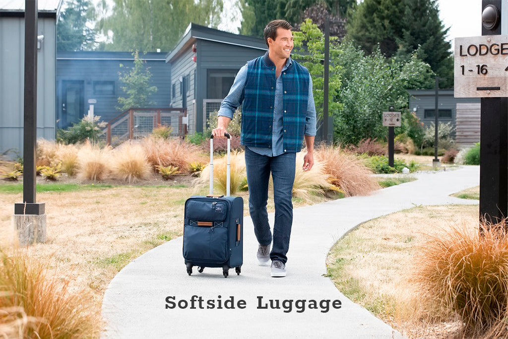 Man walking with a softside spinner suitcase