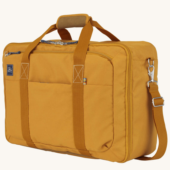 Convertible Four-Way Carry-On Whidbey 21-inch Backpack in Honey Quarter Front View in  in Color:Honey in  in Description:Angled View