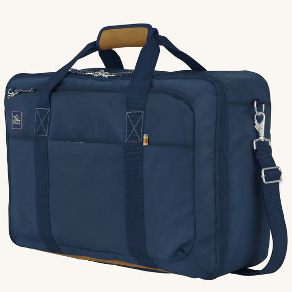 Convertible Four-Way Carry-On Whidbey 21-inch Backpack in Midnight Blue Quarter Front View in  in Color:Midnight Blue in  in Description:Angled View