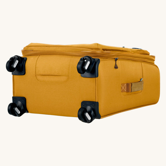 Medium Check-In Whidbey 24-inch Spinner Suitcase in Honey Bottom View in  in Color:Honey in  in Description:Bottom