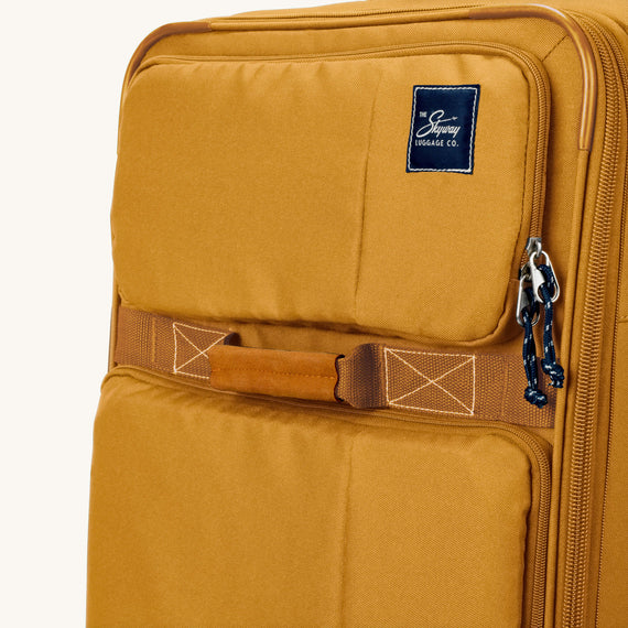 Medium Check-In Whidbey 24-inch Spinner Suitcase in Honey Close Up View in  in Color:Honey in  in Description:Exterior Detail