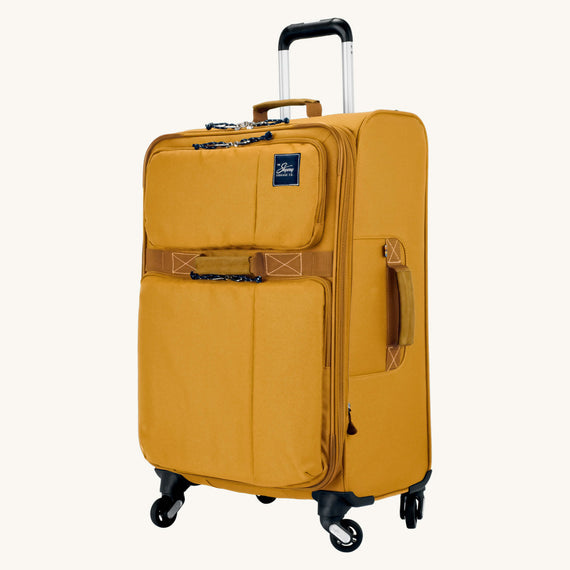 Medium Check-In Whidbey 24-inch Spinner Suitcase in Honey Quarter Front View in  in Color:Honey in  in Description:Angled View
