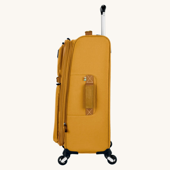 Medium Check-In Whidbey 24-inch Spinner Suitcase in Honey Side View in  in Color:Honey in  in Description:Side