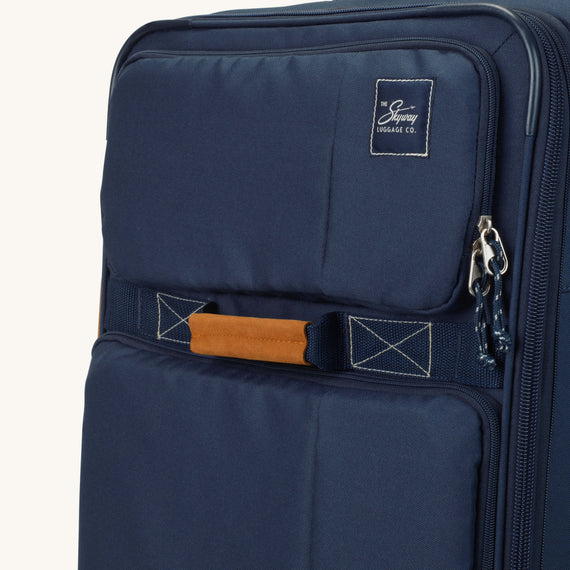 Medium Check-In Whidbey 24-inch Spinner Suitcase in Midnight Blue Close Up View in  in Color:Midnight Blue in  in Description:Exterior Detail