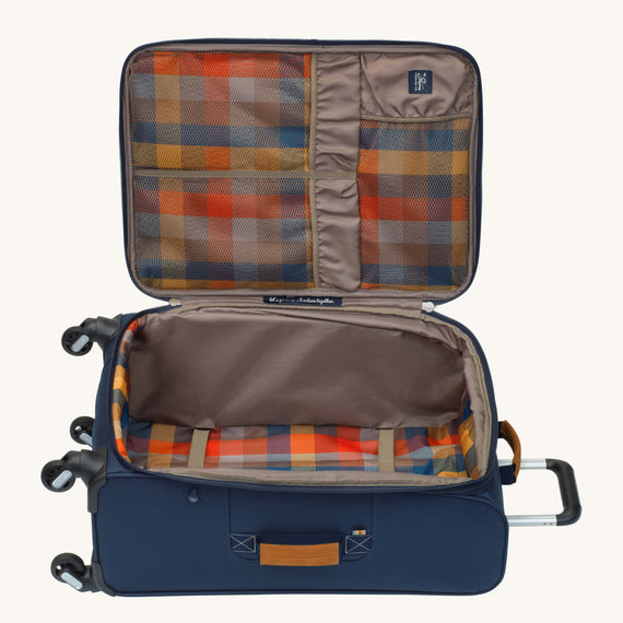 Medium Check-In Whidbey 24-inch Spinner Suitcase in Midnight Blue Open View in  in Color:Midnight Blue in  in Description:Opened