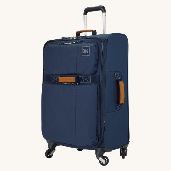 Medium Check-In Whidbey 24-inch Spinner Suitcase in Midnight Blue Quarter Front View in  in Color:Midnight Blue in  in Description:Angled View