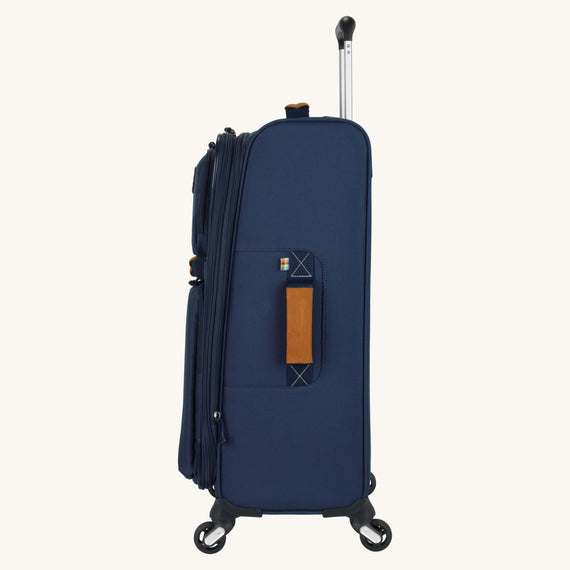 Medium Check-In Whidbey 24-inch Spinner Suitcase in Midnight Blue Side View in  in Color:Midnight Blue in  in Description:Side