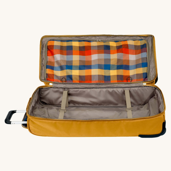 Large Rolling Duffel Whidbey 28-inch Rolling Duffel in Honey Secondary Open View in  in Color:Honey in  in Description:Bottom Compartment