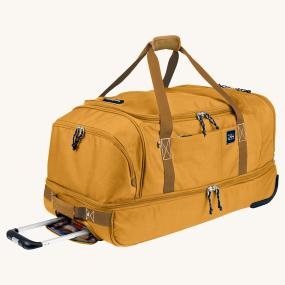 Large Rolling Duffel Whidbey 28-inch Rolling Duffel in Honey Quarter Front View in  in Color:Honey in  in Description:Angled View