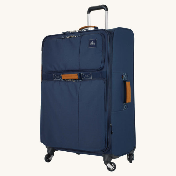 Large Check-In Whidbey 28-inch Spinner Suitcase in Midnight Blue Quarter Front View in  in Color:Midnight Blue in  in Description:Angled View