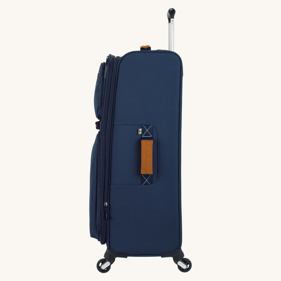 Large Check-In Whidbey 28-inch Spinner Suitcase in Midnight Blue Side View in  in Color:Midnight Blue in  in Description:Side