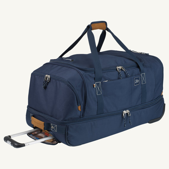 Large Rolling Duffel Whidbey 28-inch Rolling Duffel in Midnight Blue Quarterfront view in  in Color:Midnight Blue in  in Description:Angled View