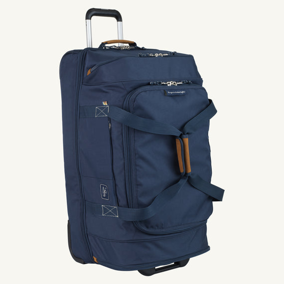 Large Rolling Duffel Whidbey 28-inch Rolling Duffel in Midnight Blue Side View in  in Color:Midnight Blue in  in Description:Angled View