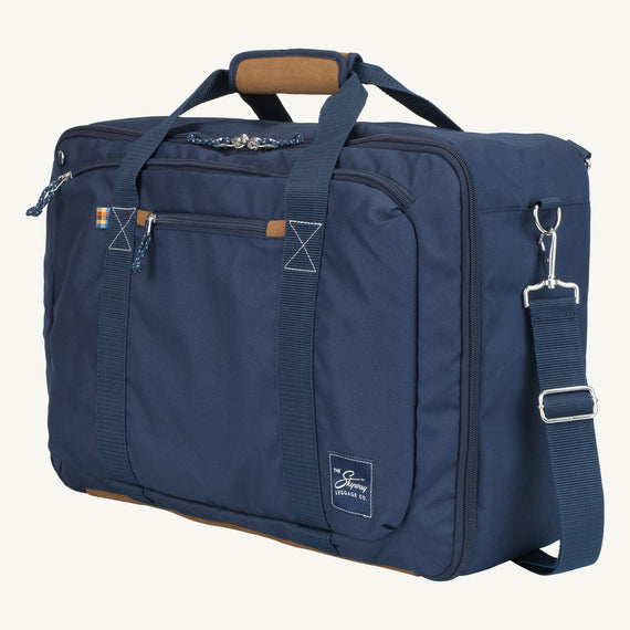 Convertible Four-Way Carry-On Coupeville 21-inch Backpack in Midnight Blue Quarter Front View in  in Color:Midnight Blue in  in Description:Angled View