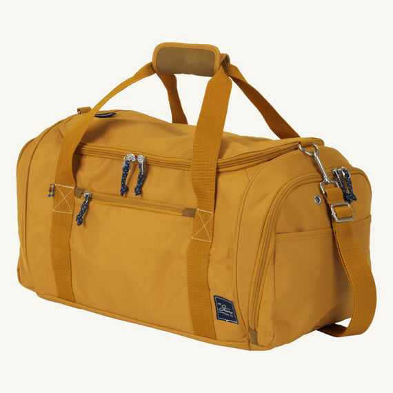 Weekender Duffel Coupeville 22-inch Duffel in Honey Quarter Front View in  in Color:Honey in  in Description:Angled View