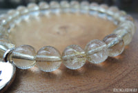 Lotus and Rutilated Quartz Bracelet