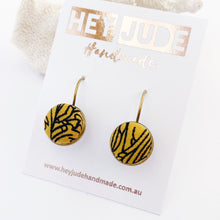 Load image into Gallery viewer, Small Bronze Bezel edge Drop Earrings-with lever arch closing back-Mustard Gold with Black line Abstract fabric button feature-Hey Jude Handmade