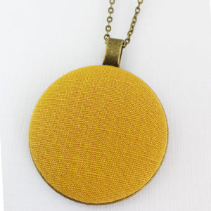 Large-Long Pendant Necklace-Antique Brass-Mustard Yellow Linen fabric feature-Bronze chain-Hey Jude Handmade