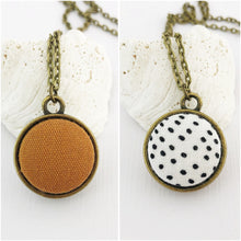Load image into Gallery viewer, Mini Bronze Pendant Necklace-Double Sided-Fabric Features-Saffron Linen and White, Black Dots-Hey Jude Handmade