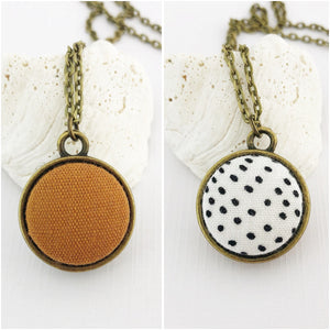 Mini Bronze Pendant Necklace-Double Sided-Fabric Features-Saffron Linen and White, Black Dots-Hey Jude Handmade