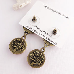 Reverse view of Hidden detail, Bronze drop earrings, Tree of Life carving