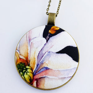 large pendant necklace, brass- on long bronze chain- with fabric feature- offset Magnolia on black- Hey Jude Handmade
