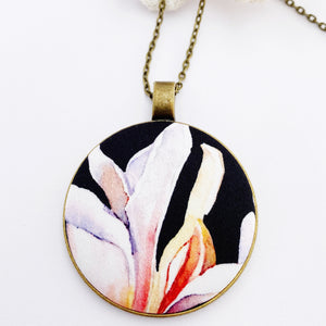 Large pendant necklace, brass-on long bronze chain- with fabric feature- white Magnolia on black- Hey Jude Handmade