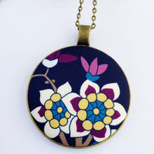 Load image into Gallery viewer, large pendant necklace, brass- on long bronze chain- with fabric feature- navy with white purple yellow blue floral- Hey Jude Handmade