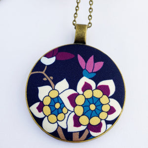 large pendant necklace, brass- on long bronze chain- with fabric feature- navy with white purple yellow blue floral- Hey Jude Handmade