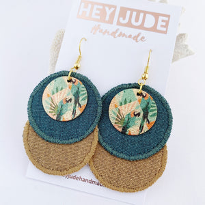 Rustic Linen Duo Dangles-Lightweight Statement Earrings- two discs of linen fabric- Pine Green + Sand coloured- with enamel painted copper embellishments with parrots- gold coloured ear wires-Hey Jude Handmade