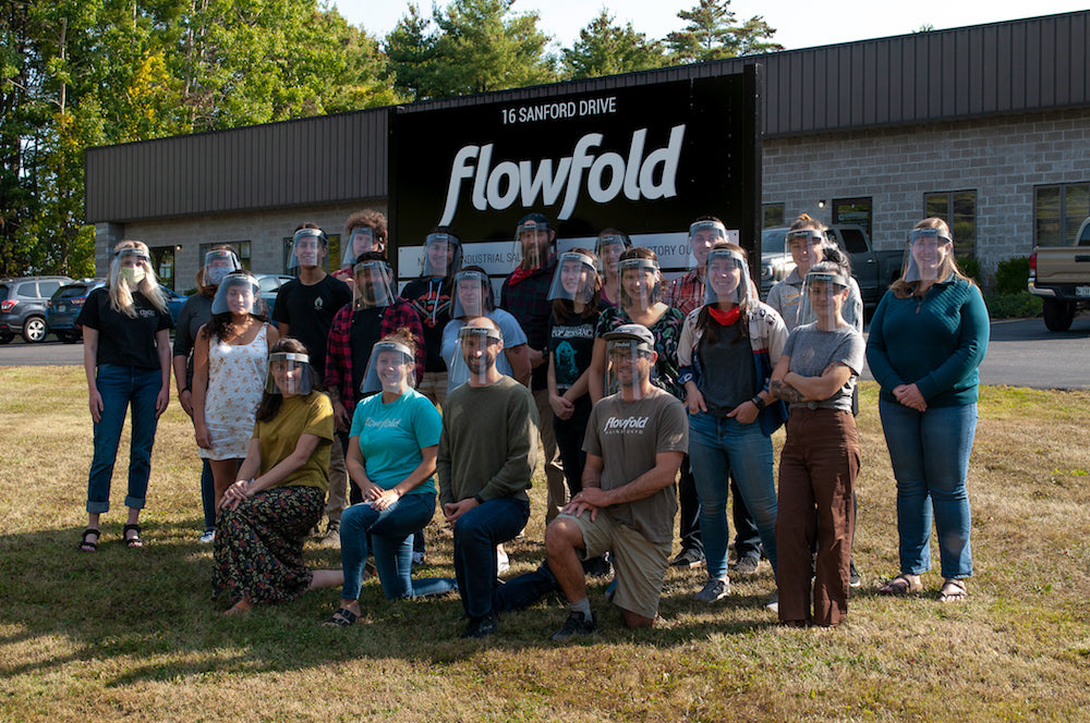 flowfold team in front of ppe manufacturing facility wearing face shields