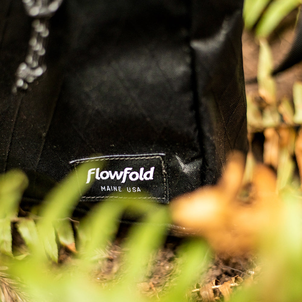 flowfold crossbody bag logo detail
