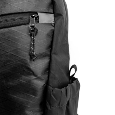 Flowfold 18L Optimist large backpack with water bottle sleeves closeup waterproof xpac fabric