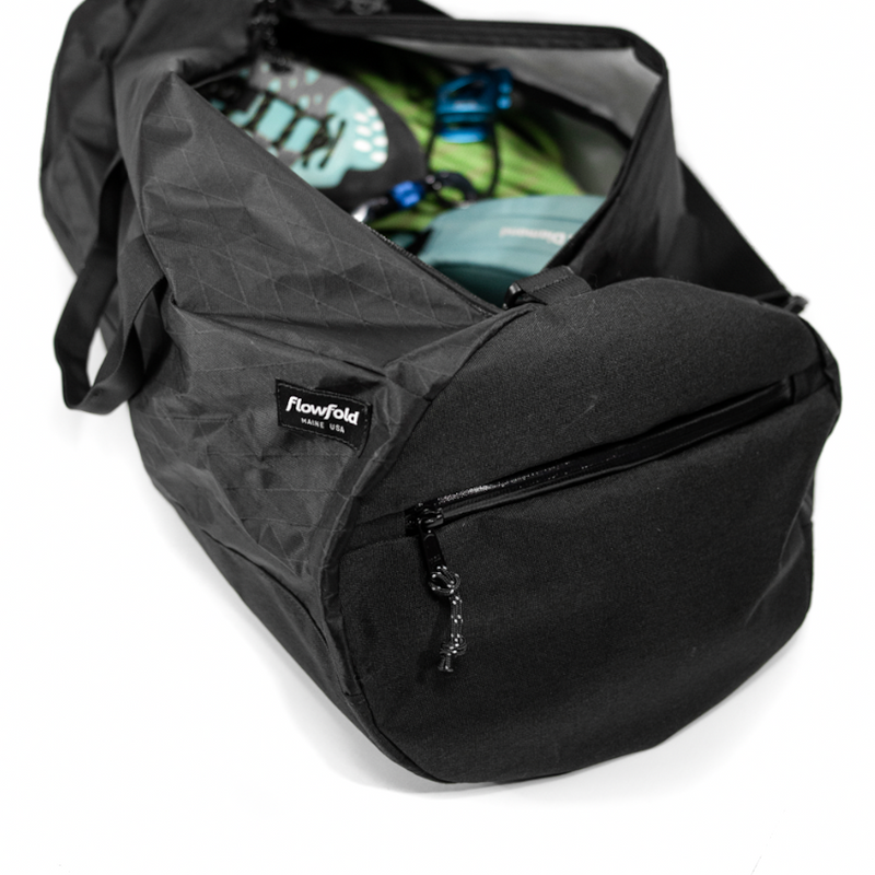 Flowfold Jet Black Stormproof Conductor Duffle bag for travel and road trips