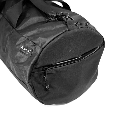 Flowfold Jet Black Conductor duffle bag side pocket