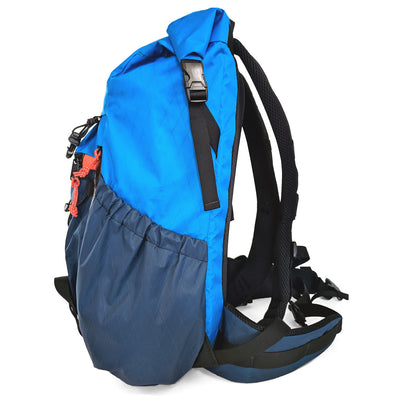 Flowfold Navy Blue with Orange Zipper Pulls Uhuru 25L Hiking Pack side pockets and waist clip view